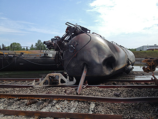 Derailed rail cars are strewn around the tracks in Lac-Mégantic, Quebec, after a deadly explosion Saturday. Photo courtesy of the Transportation Safety Board of Canada.