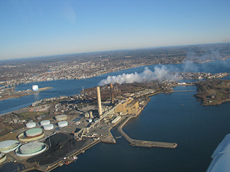 A plan by Footprint Power would replace power from oil and coal generators at Salem Harbor in Massachusetts with natural gas, adding to a downward trend in greenhouse gas emissions as gas power plants have taken off in New England. Click to enlarge. (Credit: The Conservation Law Foundation)