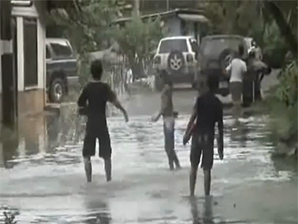 Kids playing in flood waters
