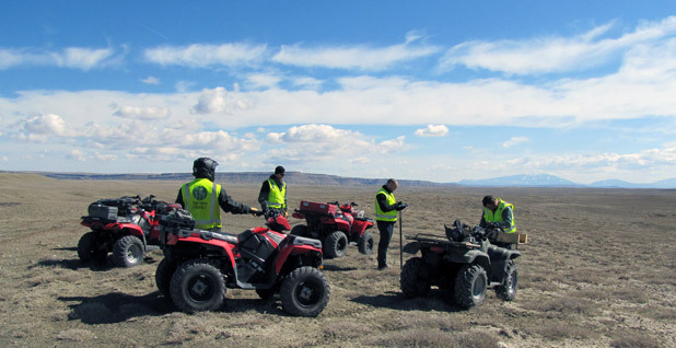 team on all-terrain vehicles