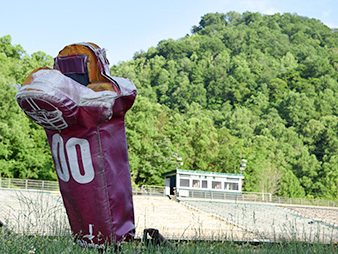 abandoned high school football field