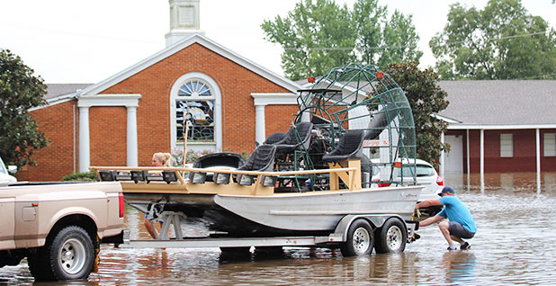 Flood street with airboat
