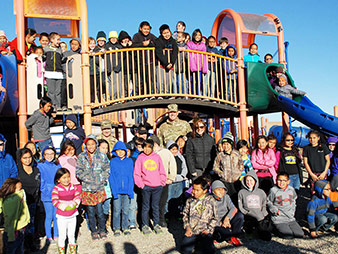 Darcy with students at Nome Elementary School