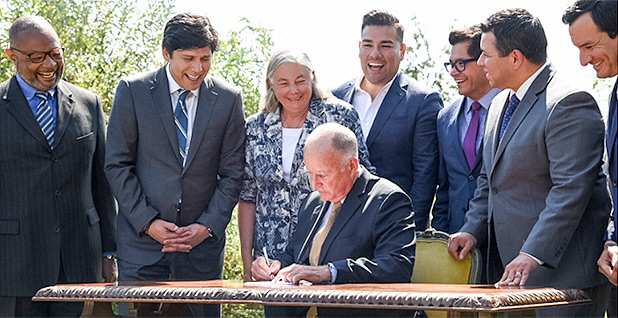 California Gov. Jerry Brown signing bill