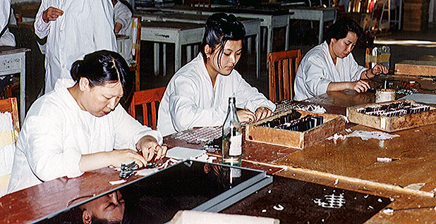 Chinese workers assembling PV control panels. Photo credit: Simon Tsuo/NREL: