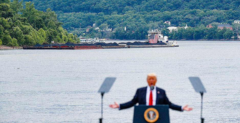 Donald Trump in front of coal barge. Photo credit: John Minchillo/Associated Press