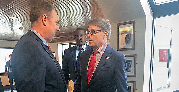 Robert Powelson and Rick Perry. Photo credit: @FERCRPowelson/Twitter