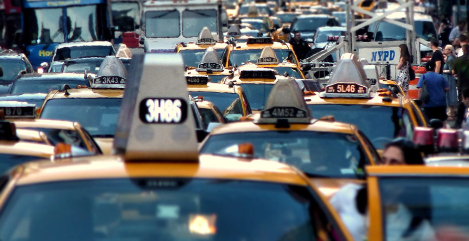 Cabs in traffic. Photo credit: joiseyshowaa/Flickr