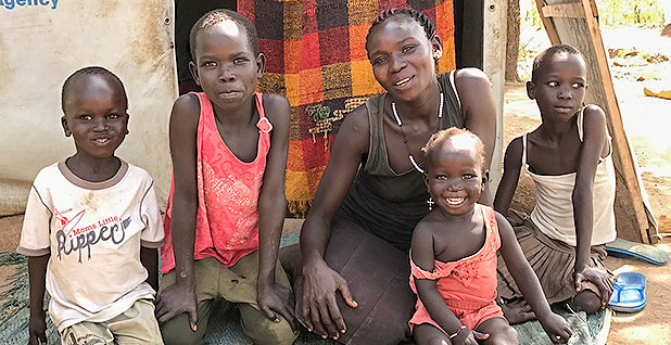 Suzan Akongo with her four children. Photo credit: Daniel Cusick/E&E News