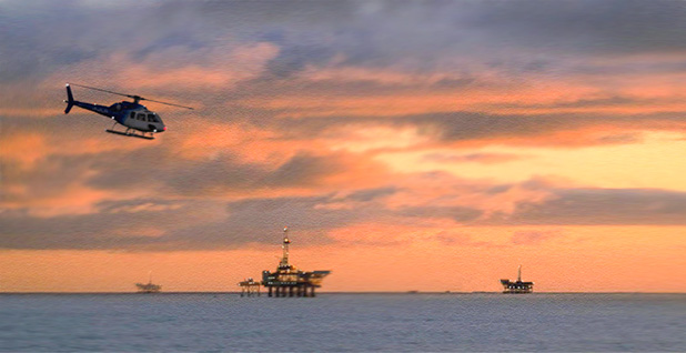 Three oil rigs at sunset. Photo credit: Bureau of Ocean Energy Management/Flickr