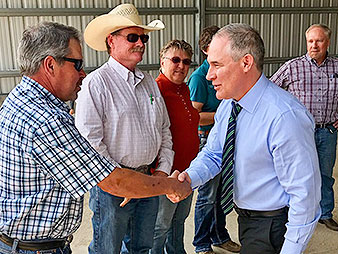 EPA Administrator Scott Pruitt with farmer in Colorado. Photo credit: @EPAScottPruitt/Twitter