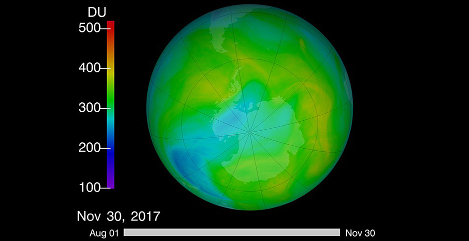 An illustration of Earth depicts the ozone hole over Antarctica in blue. Photo credit: NASA.