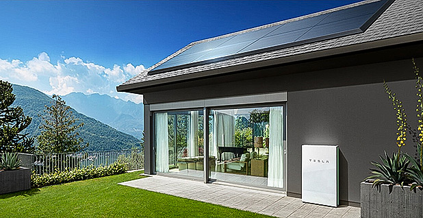 Rendering of house with solar roof. Photo credit: Tesla