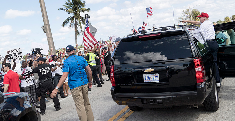 President Trump waving to supporters from an SUV in West Palm Beach, Fla.. Photo credit: Shealah Craighead/White House