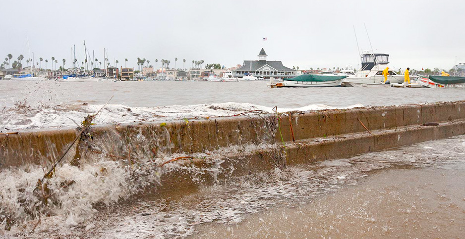 Water spills over the sea wall in Newport Beach, Calif. Photo credit: Jim Auger/Newport Beach