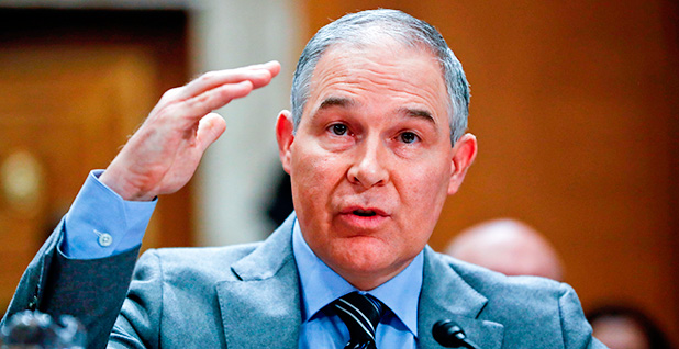 EPA Administrator is seen speaking into the microphone while gesturing with his right hand. Photo credit: Pablo Martinez Monsivais/Associated Press