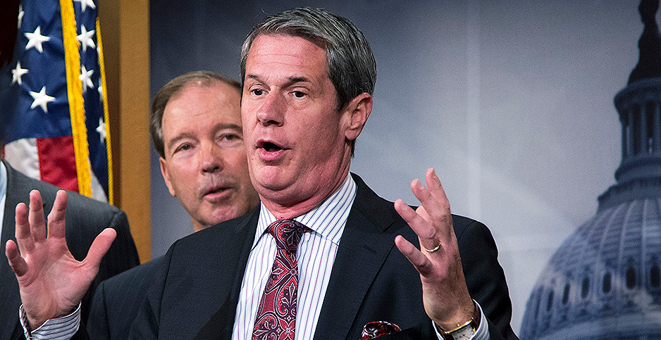 Tom Udall and David Vitter. Photo credit: Manuel Balce Ceneta/Associated Press