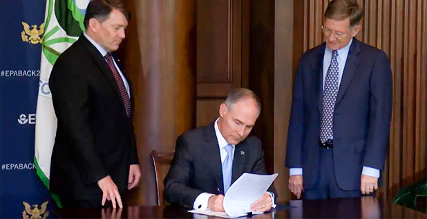 Scott Pruitt signing secret science. Photo credit: EPA