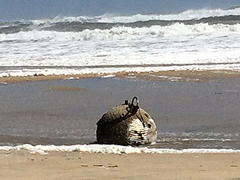 Unexploded ordnance washed ashore off the SC coast. Photo credit:  National Park Service