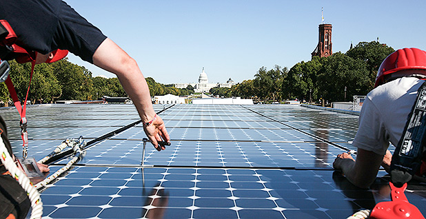 People installing solar panels on National Mall. Photo credit: Stefano Paltera/Department of Energy Solar Decathlon/Flickr