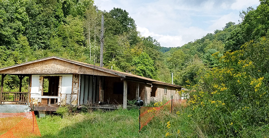 An abandoned house awaits demolition in Mobley, WVa. Photo credit: Jenny Mandel/E&E News