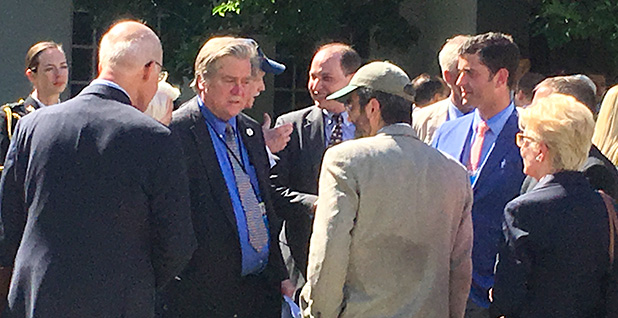 Steve Bannon talking with Joseph Bast of the Heartland Institute (in baseball cap) at the White House. Photo credit: Evan Lehmann/E&E News