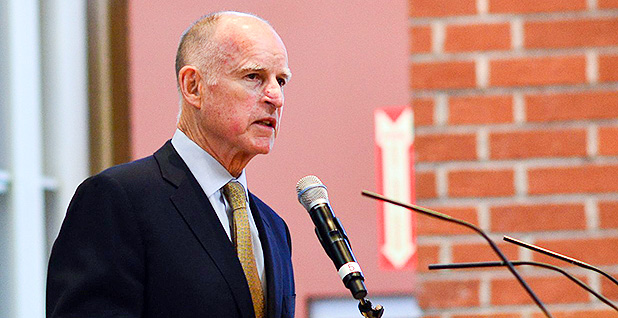 California Gov. Jerry Brown (D) speaks into a microphone. Photo credit: Neon Tommy/Flickr