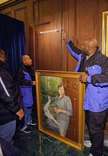 Workers hanging Lisa Jackson's portrait at EPA. Photo credit: Rep. Bill Cassidy's (R-La.) office