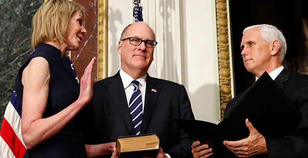Coal executive Joe Craft (center) held a Bible as his wife, Kelly Knight Craft, was sworn in as U.S. ambassador to Canada by Vice President Mike Pence. Photo credit: Alex Brandon/Associated Press