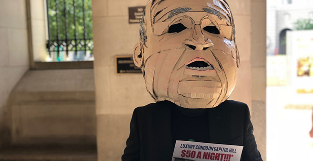 A protester imitated EPA Administrator Scott Pruitt after the agency chief announced his resignation yesterday. Photo credit: Adam Aton/E&E News