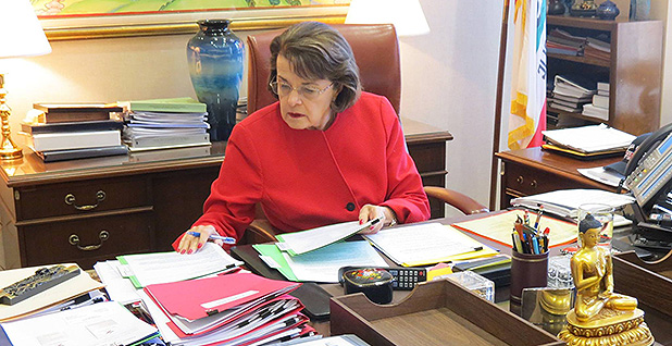 Sen. Dianne Feinstein (D-Calif.) is seen at her desk. Photo credit: Sen. Dianne Feinstein/Facebook.