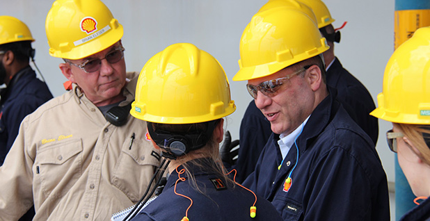 Rep. Steve Scalise (R-La.) is seen in a yellow hardhat talking with employees of Shell Oil Co. Photo credit: Steve Scalise/Facebook.