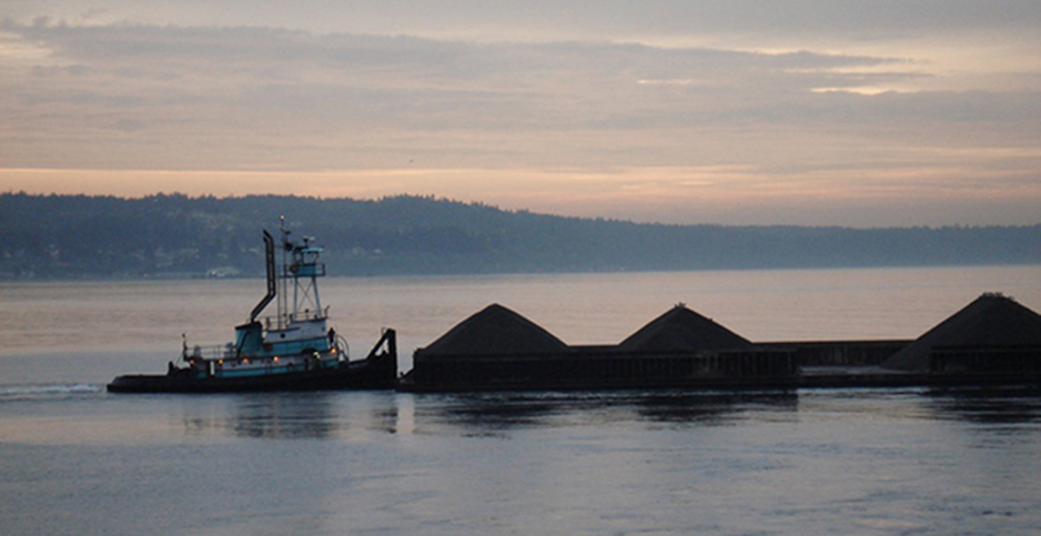 A coal barge is seen in Washington State. Photo credit: Albert/Flickr