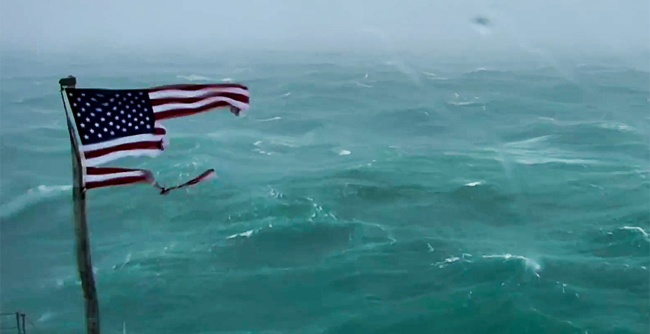 An American flag rips in Hurricane Florence's strong winds. Photo credit: Frying Pan Ocean Cam/Explore.org