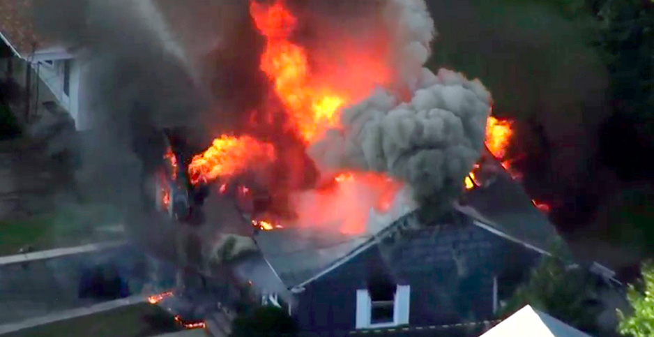 House in flames. Photo credit: WCVB/Associated Press