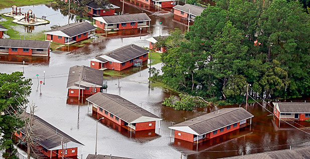 Houses sit in floodwater caused by Hurricane Florence. Photo credit: Jason Miczek/Reuters/Newscom