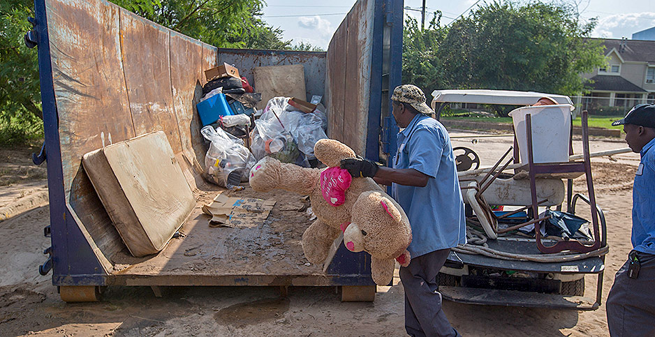 Workers threw away debris and ruined possessions. Photo credit: Michael Stravato/Polaris/Newscom