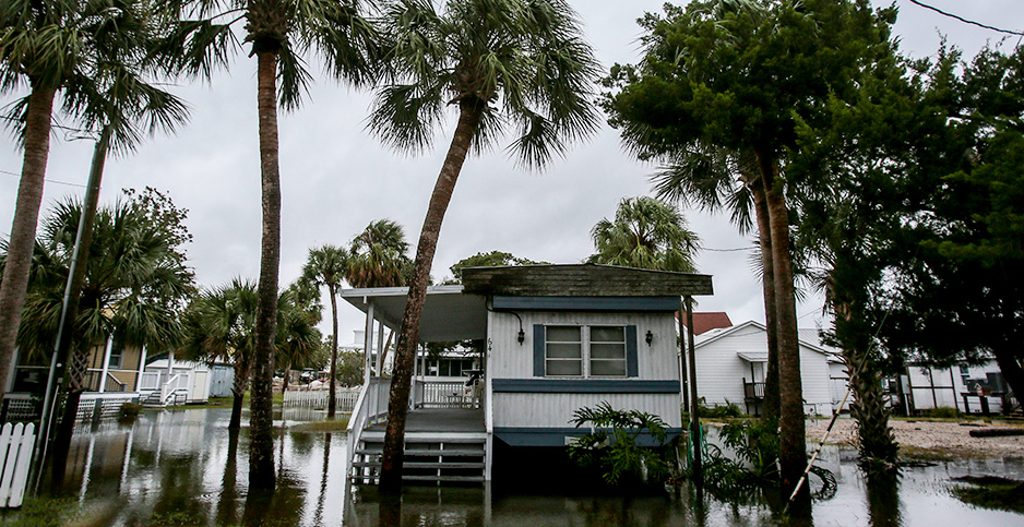 Flood around a mobile home. Photo credit: Bronte Wittpenn/Times/ZUMA Press/Newscom
