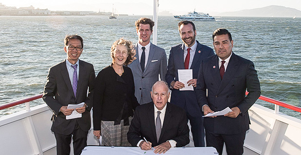 California Gov. Jerry Brown (D) signed climate legislation in September on an electric ferry in San Francisco Bay. Photo credit: Jerry Brown/Twitter