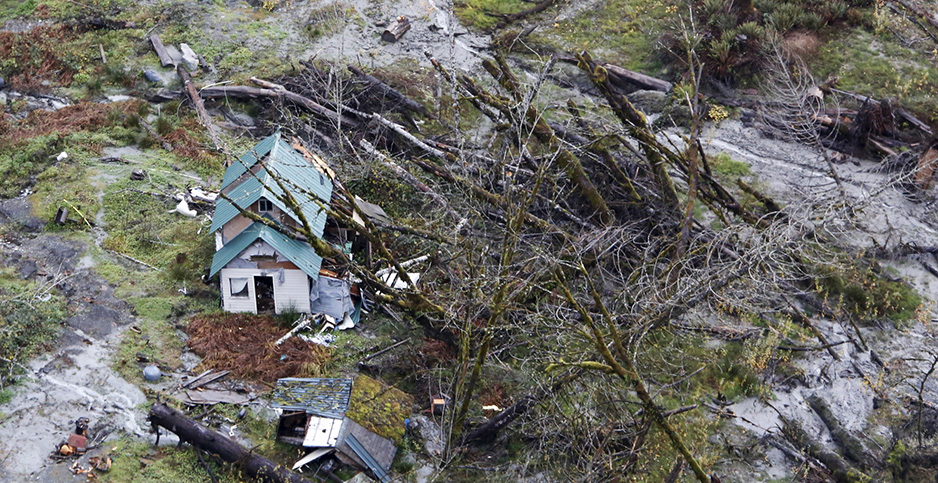 A structure in Washington state was damaged by a storm that triggered mudslides and flooding in 2015. Photo credit: Jason Redmond/Reuters/Newscom