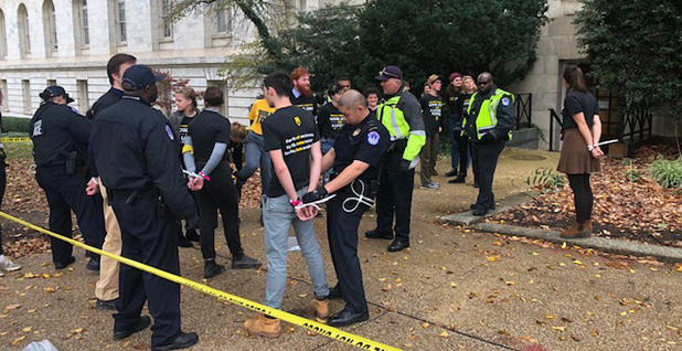 Protesters were arrested outside the Cannon House Office Building yesterday. Photo credit: Mark K. Matthews/E&E News