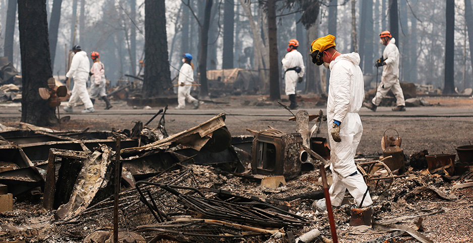 Rescuer workers searched debris in Paradise, Calif., after a wildfire that has killed at least 56 people. Photo credit: Li Ying Xinhua News Agency/Newscom