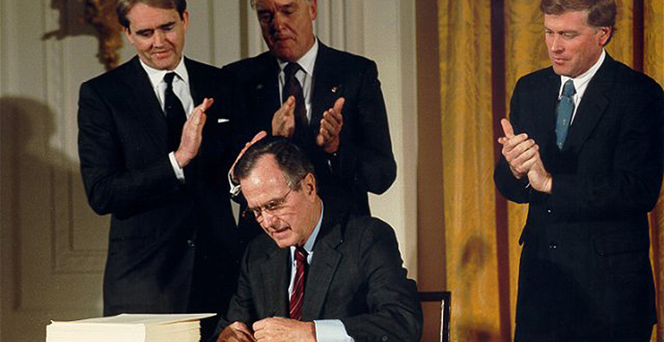 EPA Administrator Bill Reilly (left) watches as President George H.W. Bush signs the Clean Air Act Amendments in 1990. Credit: Carol T. Powers/White House