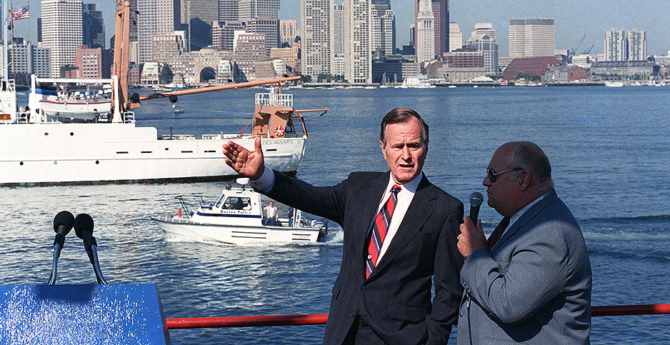 Vice President George H.W. Bush gestures from a boat in Boston Harbor on Sept. 1, 1988. Photo credit: AP Photo/J. Scott Applewhite