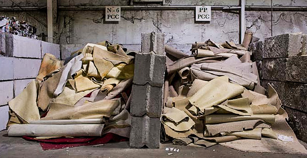 Piles of discarded carpet. Photo credit: Less Stone/ Changing Markets Foundation/Ecology Center