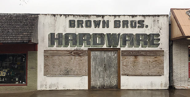 A boarded up storefront in Premont, Texas. Photo credit: Benjamin Hulac/E&E News