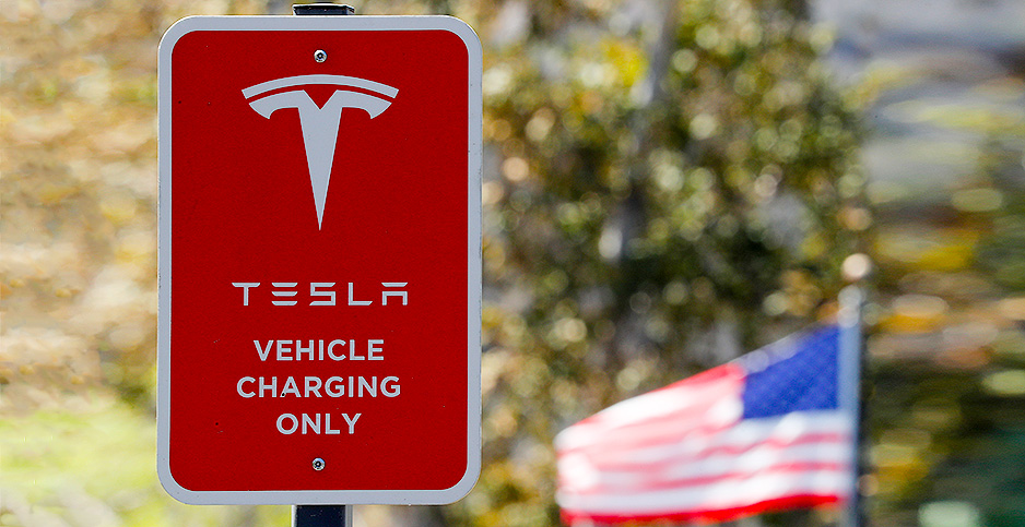 A parking sign at a newly installed Tesla Supercharger station in Carlsbad, Calif. Photo credit: MIKE BLAKE/REUTERS/Newscom