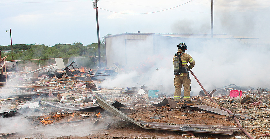 Firefighter fights flames Midland, Tx. Photo credit: Midland County fire marshal's office