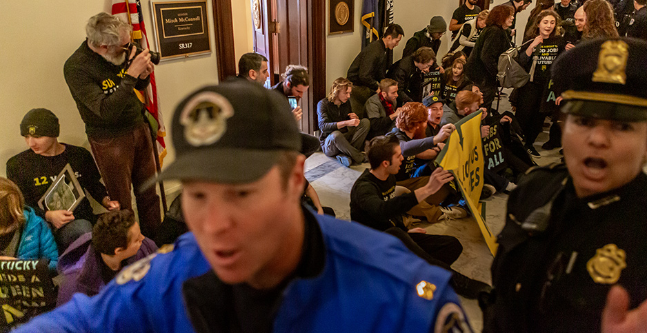 Climate activists crowd a Senate corridor last month, resulting in 42 arrests. Photo credit: Pacific Press/Sipa USA/Newscom