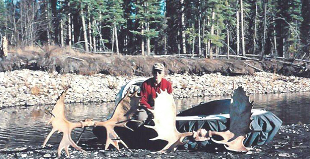 John Sturgeon with moose antlers and his hovercraft. Photo credit: Sturgeon